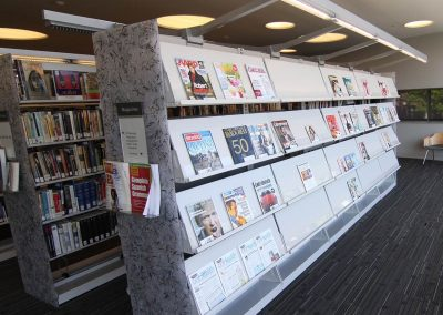 magazine-racks-on-cantilever-library-shelving-with-unique-acrylic-endpanels