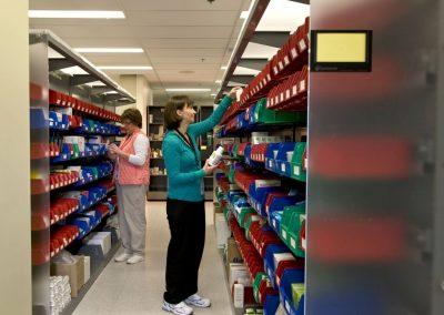 pharmacy-technicians-gather-medicine-from-modular-bin-storage