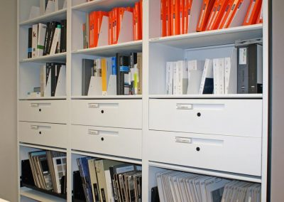 toronto-interior-design-company-using-4-post-shelving-with-drawers-for-reference-material