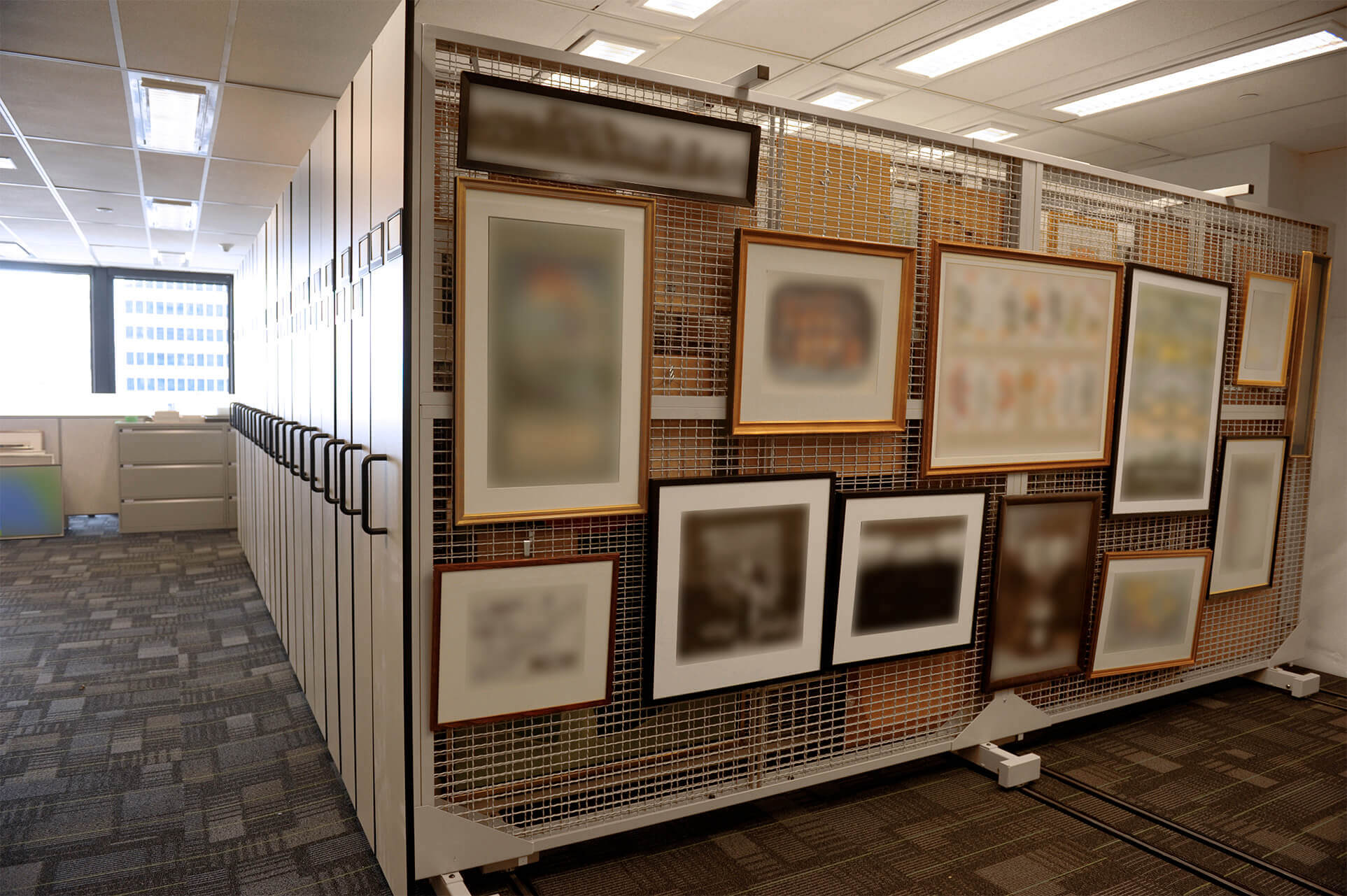 Fine art storage on compact mobile art racks at ontario bank